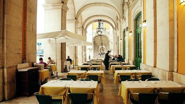 Martinho da Arcada café terrace view with tables and café umbrellas