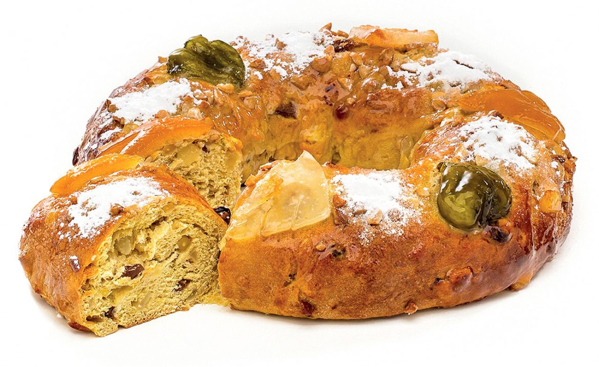 Confeitaria Nacional's King's Cake with candied fruit and powdered sugar on top