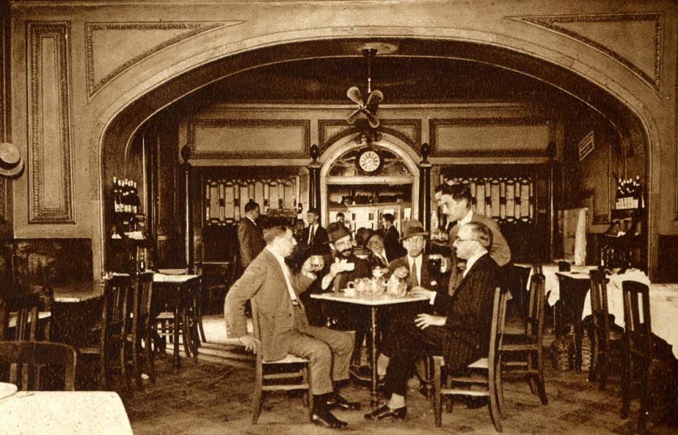 Old photo of Fernando Pessoa having coffee with friends at Martinho da Arcada in Lisbon